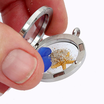 Placing the sand inside your locket