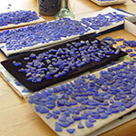 sorting sea glass for blue sea glass earrings in gold